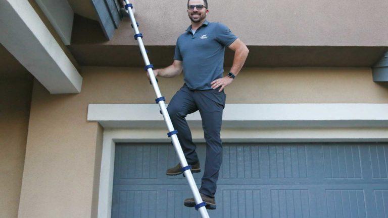 Darrel Fall Owner, Vegas Valley Inspections climbing ladder