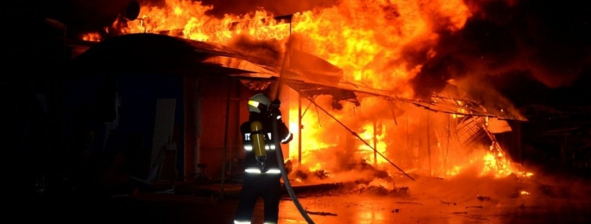 A fireman putting out a deadly home fire