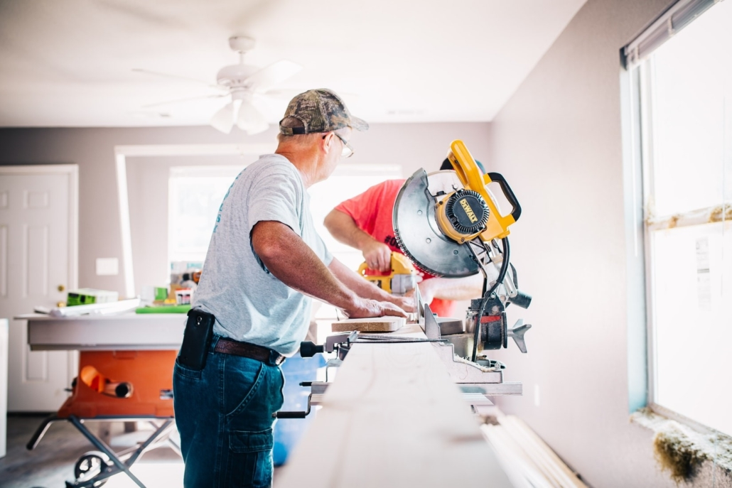 plumbers working using a machine and saw