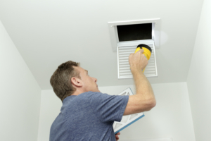 home inspector inspecting vent rapid city sd