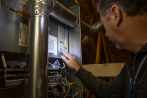 home inspector inspecting furnace rapid city sd spearfish