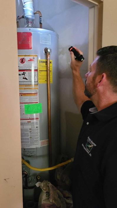 Roy Cassada Inspecting Water Heater