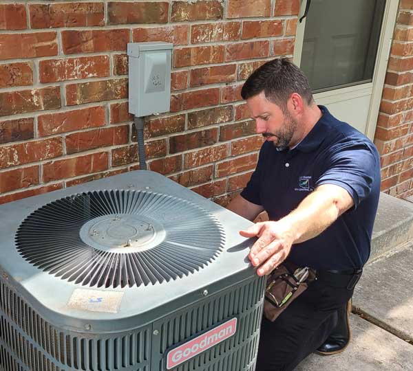 Roy Cassada Inspecting Air Conditioner